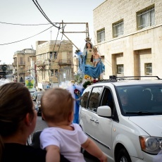 Haifa Christians relive differently the procession of Our Lady of Mt. Carmel