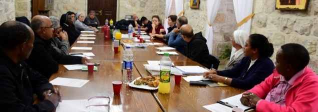 Members of the Vicariate for migrants and asylum seekers meet at the Latin Patriarchate